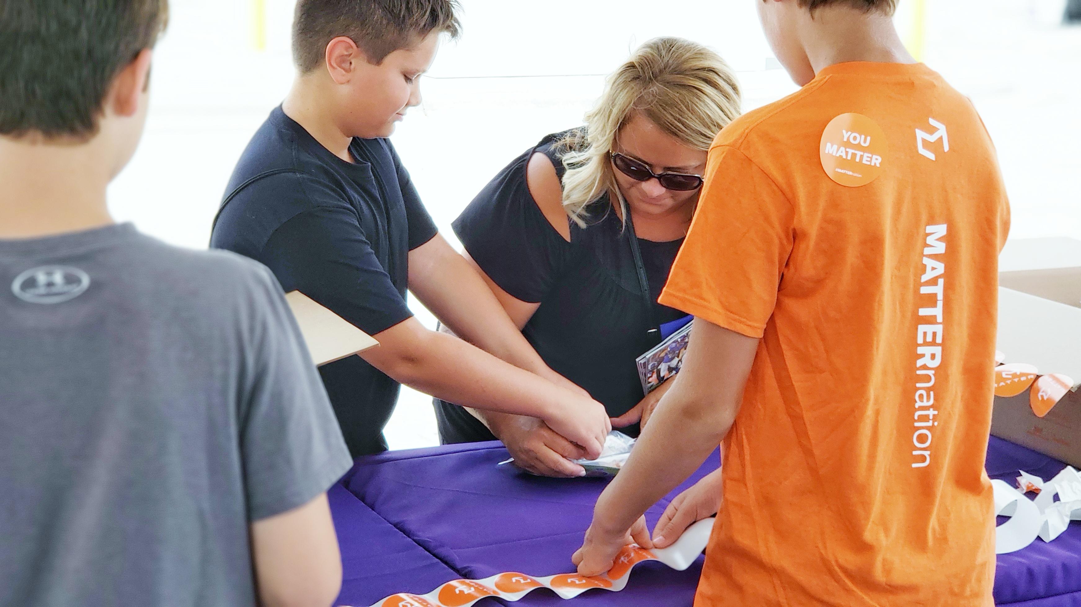 Vikings Fan Packing MATTERbox Snack Packs at Training Camp